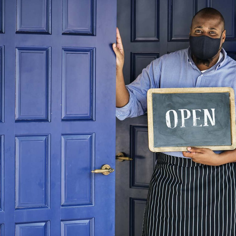 Black business owner in mask during new normal post pandemic
